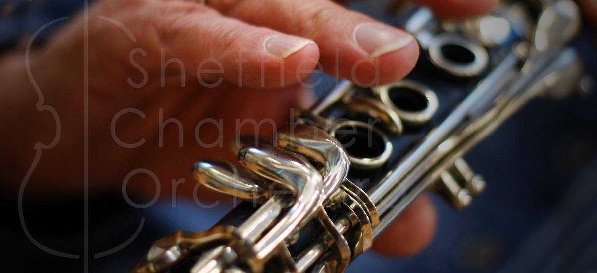 SCO logo and clarinet